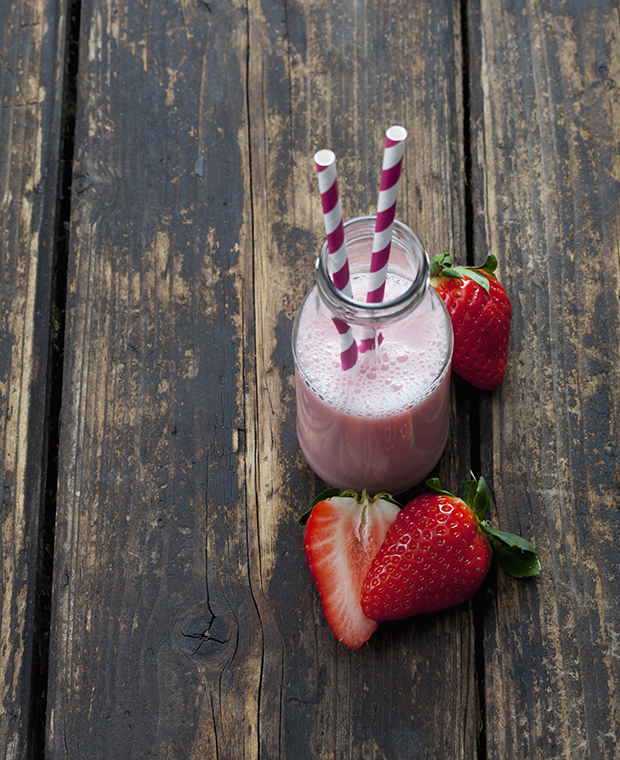 Glass bottle of strawberry smoothie