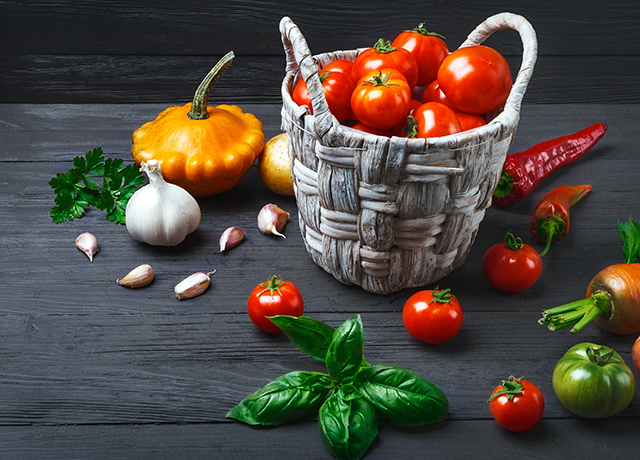 Vegetables and spices in basket at wooden